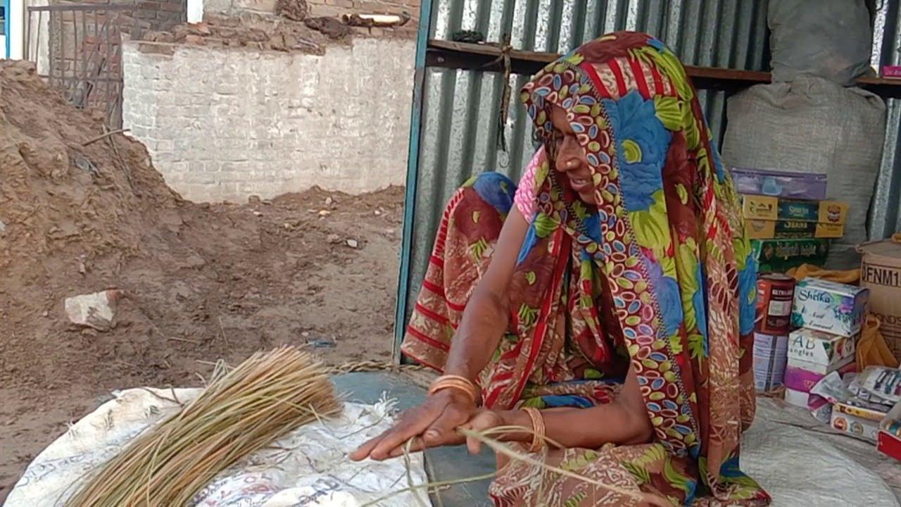 Women making comfortable cots