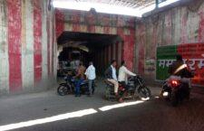 Truck stuck under the bridge