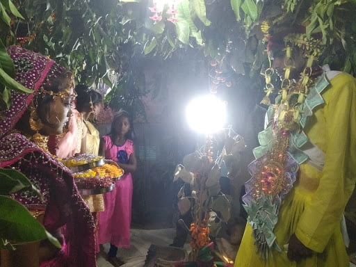 Rekha and Kishan face the bright lights of the camera and a future of married life together at their nuptials in 2019 in Banda.