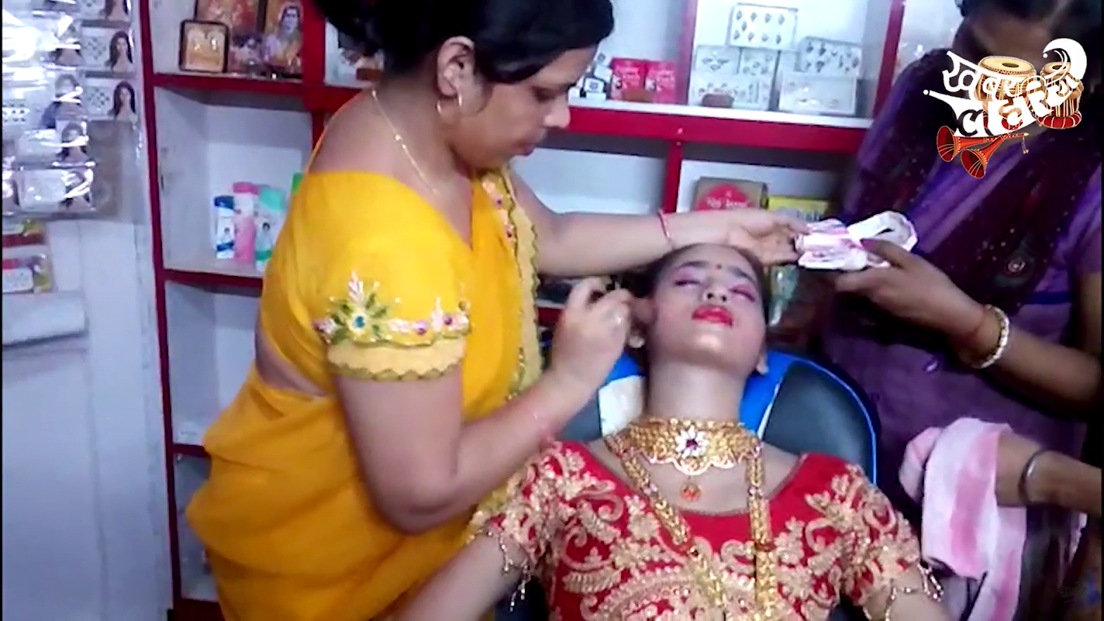 A bride being made up at a beauty parlour in Faizabad in 2018