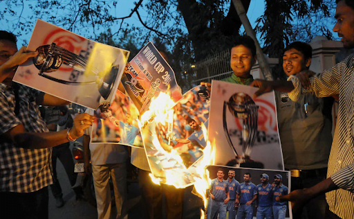 Angry Indian cricket-fans in Agartala burn posters of the Indian cricket team after they lost the World Cup semi-final to Australia in 2015. Photo: PTI.